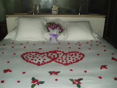 rose petals on bed 1 year anniversary bed heart made with rose petals
