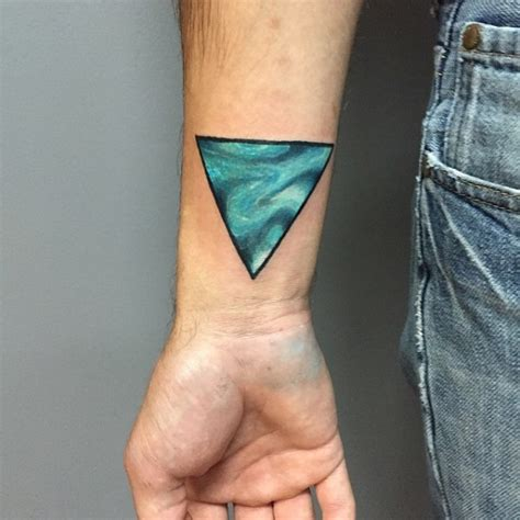 triangle wrist tattoo black ink eye in triangle design for wrist
