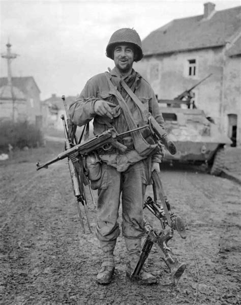 Am American soldier with a captured German MP.40 and two
