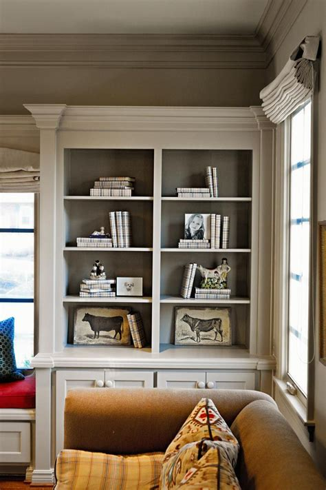 painting built in bookcases molding on the bookshelves with contrasting color painted