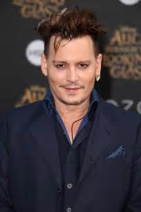 Johnny depp s friends including director terry gilliam continue to