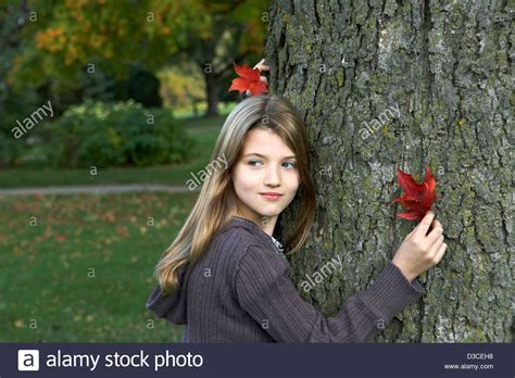 7 year old girl stock photo beautiful 7 year old girl holding colorful autumn leaf