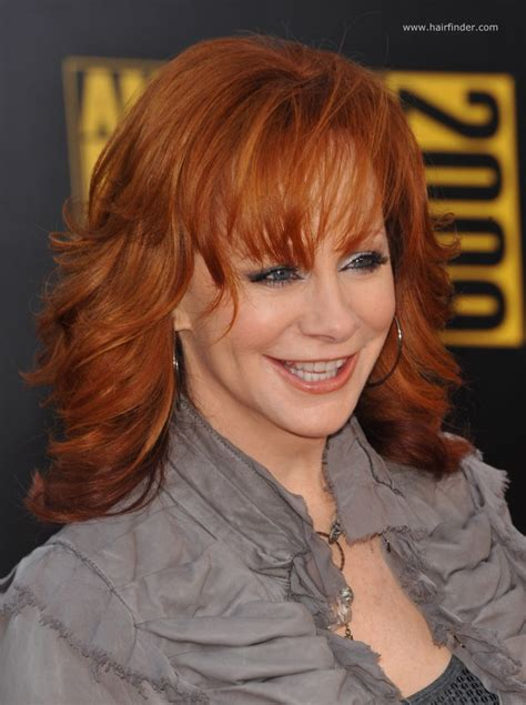 hairstyle bangs for fifty plus reba mcentire long chiseled hairstyle for 50 plus