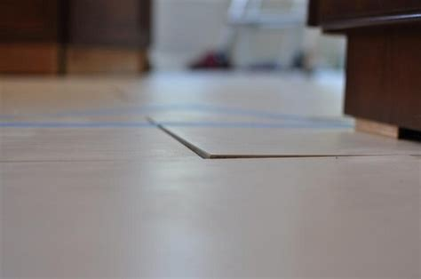 tripping on uneven floor tiles just installed help