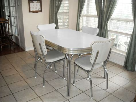 vintage retro 1950 s white kitchen or dining room table with 4 chairs