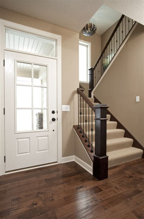 wood plank tile on staircase with white painted railings ideas photo of hardwood flooring stairs banister trim doors painting