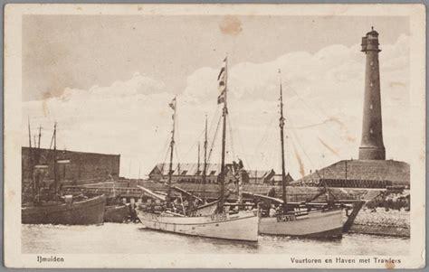 sleepboot cornelia ijmuiden vuurtoren en haven met trawlers sic loggers