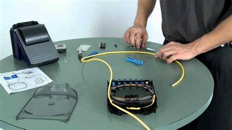 fiber optic splicing table pigtail routing and fusion splicing 900 to 900 in a splice