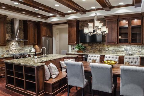 Custom wood cabinets along with a large island with built