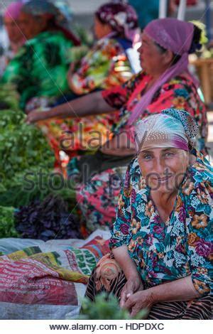 uzbek women selling traditional wedding skullcaps and dresses sunday uzbekistan women in traditional dress stock photo royalty