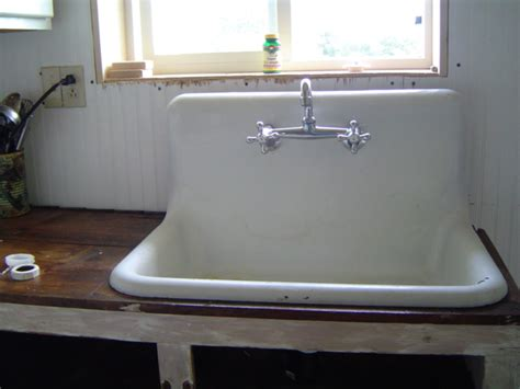 white old kitchen sink made of ceramic material and