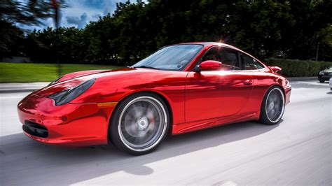 wrapped cars porsche 911 carrera red chrome vinyl wrap by florida car