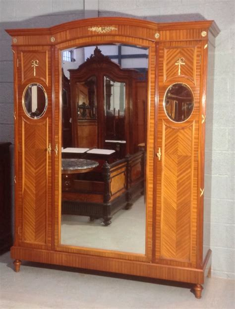 triple armoire mahogany and brass french triple armoire 526072