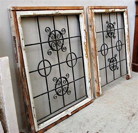 iron window pair of square wrought iron windows windows and shutters