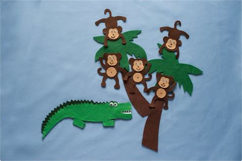 5 little monkeys swinging on a tree five cheeky monkeys swinging in a tree felt board magic