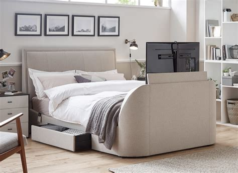 bed tv table oatmeal fabric tv bed frame dreams