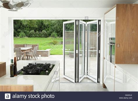 Patio Doors That Both Open Kitchen With Open Patio Doors Stock Photo Royalty Free