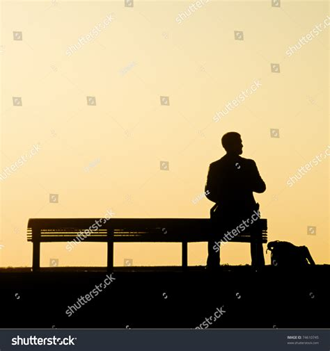 benching alone man alone on bench looks to right stock photo 74610745