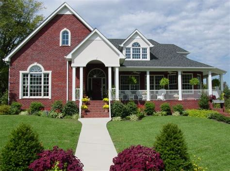 brick house with a porch wrap around porch house plans