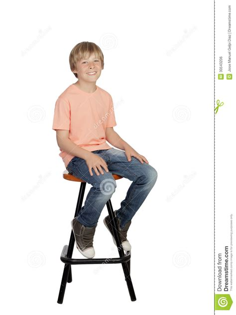 Sit On It by Smiling Boy With Orange T Shirt Sitting On A Stool Royalty