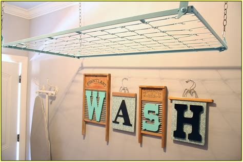 hanging pictures ideas laundry room hanging rack home design ideas
