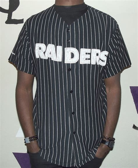 design raiders jersey this raiders baseball jersey is all black with silver