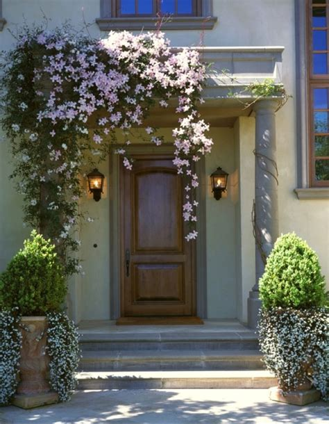 curb appeal front entrance soften an entrance with clematis and planters with boxwood