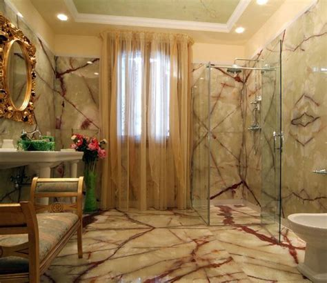 Bathroom: Green Onyx tiles on walls and floor  .   Dream