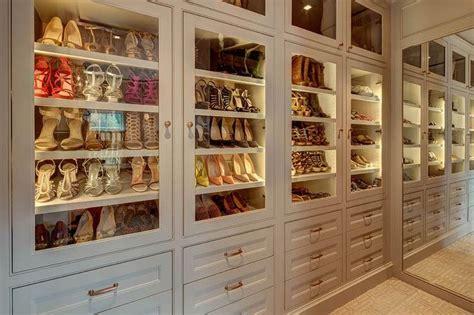 Shoe Closet With Doors Walk In Closet With Paneled Bi Fold Wardrobe Closet Doors Transitional 1000 Ideas About Shoe Shelves On Pinterest Shoe Racks Closet And Shelves