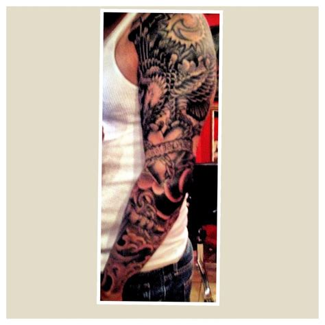 northstar tattoo nyc by daniel cotte full sleeve eagle holding a heart