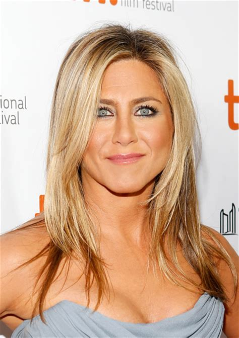 jennifer aniston reveals brazilian blowdry is reason