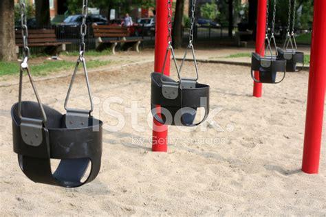 swing set toronto swing set at a toronto playground stock photos
