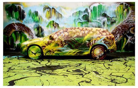 chinese graffiti artist hua tunan turns  volvo   dragon   art installation