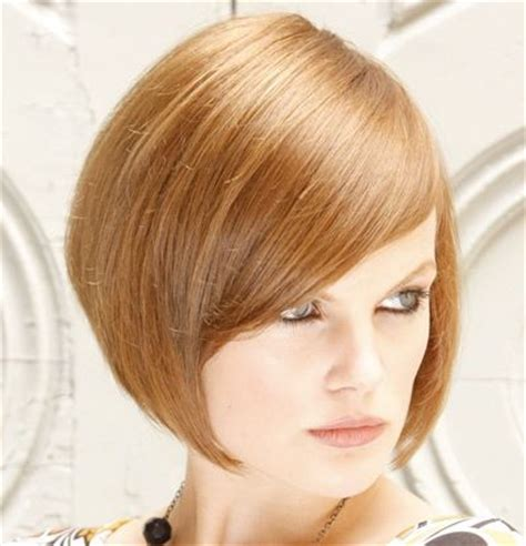 slanted fringe style auburn straight hair in chic angled bob hairstyle with