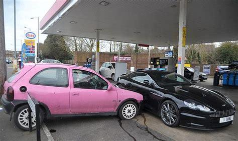 pink aston aston martin dbs crash involving a pink corsa