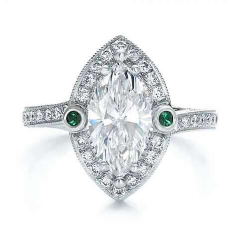 custom marquise with halo and emerald engagement