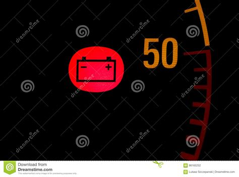 red battery light car battery low red light icon on car dashboard stock photo