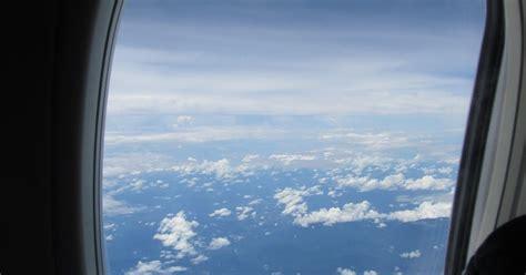 adie  pemandangan  balik jendela pesawat