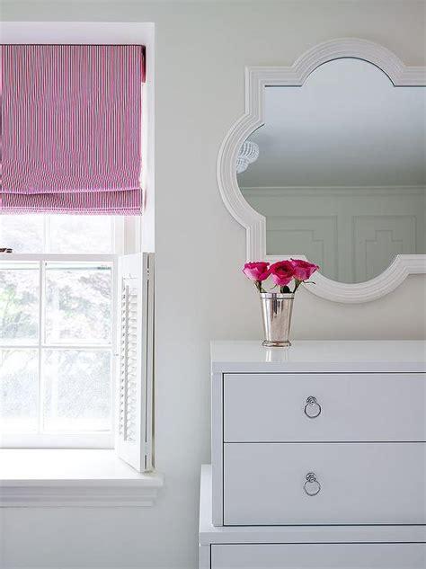 white mirror above dresser bedroom white plantation shutters design ideas