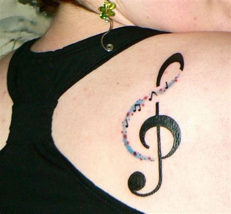 music note tattoo on shoulder 35 awesome music tattoos for creative juice