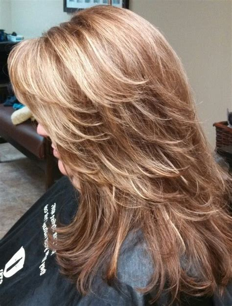 foil hair colors with blondies red brown base color with heavy foils of caramel blonde