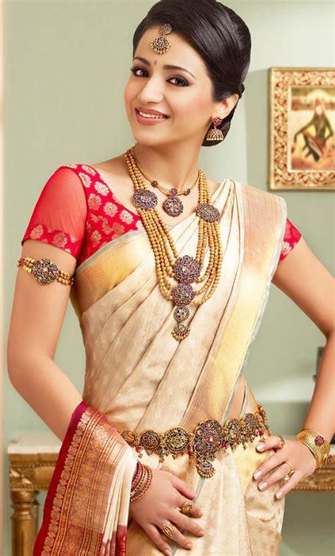 bridal hairstyles for silk saree trsha in half white pattu saree and jewellery bridal
