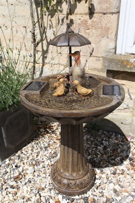 solar powered water feature duck family