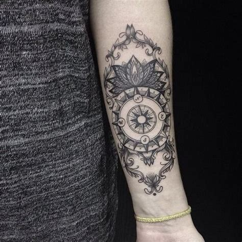 dotwork rose compass tattoo on left arm by daniel rozo 50 best compass tattoo designs and ideas