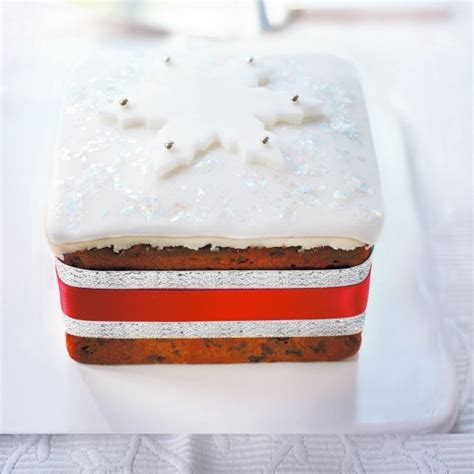 large christmas cake woman and home