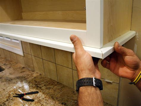 kitchen cabinet bottom molding how to install a kitchen cabinet light rail how tos diy