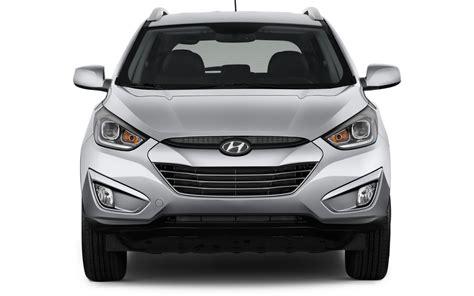 comparison hyundai tucson gls   mitsubishi outlander phev hs hybrid  suv drive