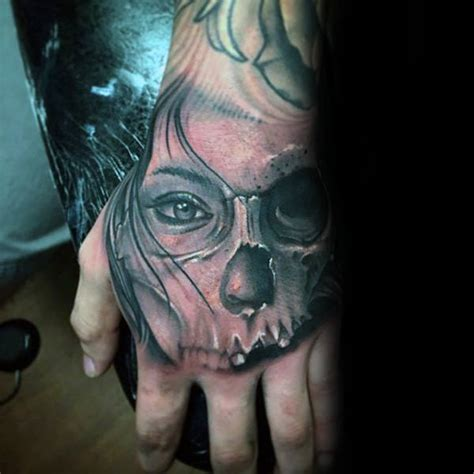 tattoo for half hand 80 skull hand tattoo designs for men manly ink ideas