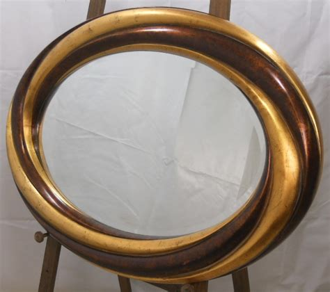 oval mirror with bronze color frame wall mirror bathroom oval frame gilt bronze two tone hanging wall mirror sold