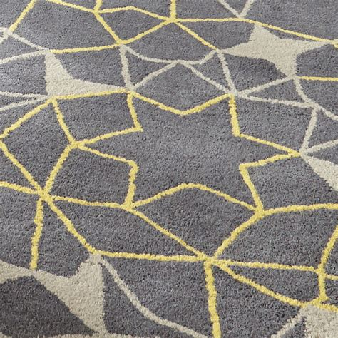 grey pattern rug uk grey yellow geometric rug 100 wool arrows stars hand